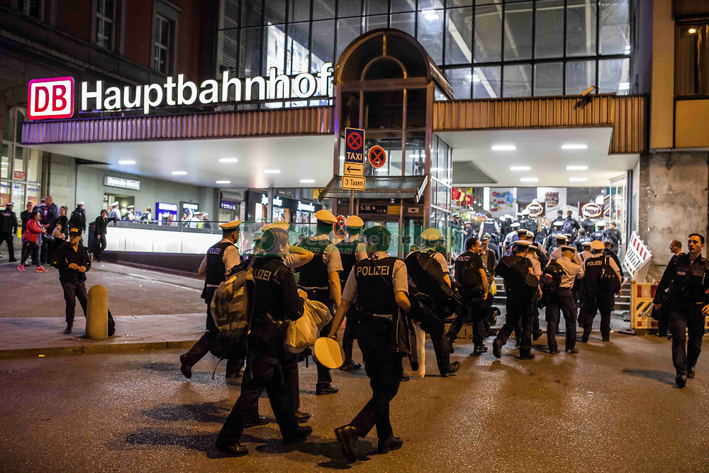 April 17, 2018 - Munich, Bavaria, Germany - During the night of April 17-18, the Munich Hauptbahnhof (train station) was closed for a large counter-terrorism training exercise, complete with the discharge of firearms, pursuits of suspects, and explosions.  The main exercise began at midnight and proceeded until 4am and was designed to simulate a terrorist commando unit attacking the Munich Central Station (Hauptbahnhof), which the anti-terrorism units were instructed to neutralize. Furthermore, emergency teams tended to injured victims.  This is also designed to coincide with an exercise on Munich's A9 Autobahn.  In total, 2,300 personnel from police, fire, and rescue .In order to prevent onlookers, the sides of the building were draped with tarps, along with trains on tracks to block views.  Major portions of the city streets in the area were also completely shut off to any form of traffic, including public transit. (Credit Image: © Sachelle Babbar via ZUMA Wire)