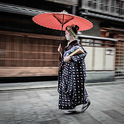 Maiko going to work under the rain, Kyoto, Japan