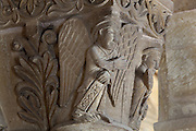 Carved capital with angels, in the galleries of the Abbatiale Sainte-Foy de Conques or Abbey-church of Saint-Foy, Conques, Aveyron, Midi-Pyrenees, France, a Romanesque abbey church begun 1050 under abbot Odolric to house the remains of St Foy, a 4th century female martyr. The church is on the pilgrimage route to Santiago da Compostela, and is listed as a historic monument and a UNESCO World Heritage Site. Picture by Manuel Cohen