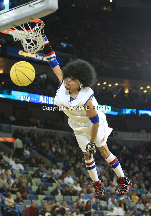 28 January 2009:  A halftime slam dunk performance during a 94-81 win by the New Orleans Hornets over the Denver Nuggets at the New Orleans Arena in New Orleans, LA. The Hornets wore special throwback uniforms of the former ABA franchise the New Orleans Buccaneers for the game as they honored the Bucs franchise as a part of the NBA's Hardwood Classics series. .