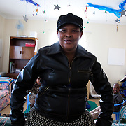 The Stars Foundation visiting Home from Home in Cape Town, South Africa...Nomasango Xabanisa who runs a home for severely disabled children. In the living room with her children...Home from Home provide security for children who are either orphans or have been abandoned, neglected or abused . Many of the children have suffered severe abuse and more than half are HIV positive. Home from Home set up foster homes of no more than six children in local communities where there is a need and employ women to run the homes and become the registered foster mother of the children.