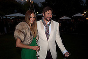YASMINE LEBON; SIMON LEBON, The Summer party 2011 co-hosted by Burberry. The Summer pavilion designed by Peter Zumthor. Serpentine Gallery. Kensington Gardens. London. 28 June 2011. <br /> <br />  , -DO NOT ARCHIVE-© Copyright Photograph by Dafydd Jones. 248 Clapham Rd. London SW9 0PZ. Tel 0207 820 0771. www.dafjones.com.