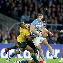 Ramiro Moyano of Argentina is tackled by Will Genia and Rory Arnold of Australia during the The Rugby Championship match between Argentina and Australia at Twickenham Stadium, Twickenham - 08/10/2016<br />