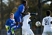 Mount Anthony's Ben Winslow (7) leaps over Burlington's Alex Dinklage (8) to head the ball during the quarterfinal boys soccer game between Mount Anthony and Burlington at Buck Hard Field on Friday afternoon October 23, 2015 in Burlington. (BRIAN JENKINS/ for the FREE PRESS)