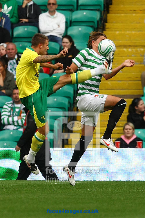 Picture by Paul Chesterton/Focus Images Ltd +44 7904 640267.24/07/2012.Anthony Pilkington of Norwich and Thomas Rogne of Celtic in action during the Friendly match at Celtic Park, Glasgow.