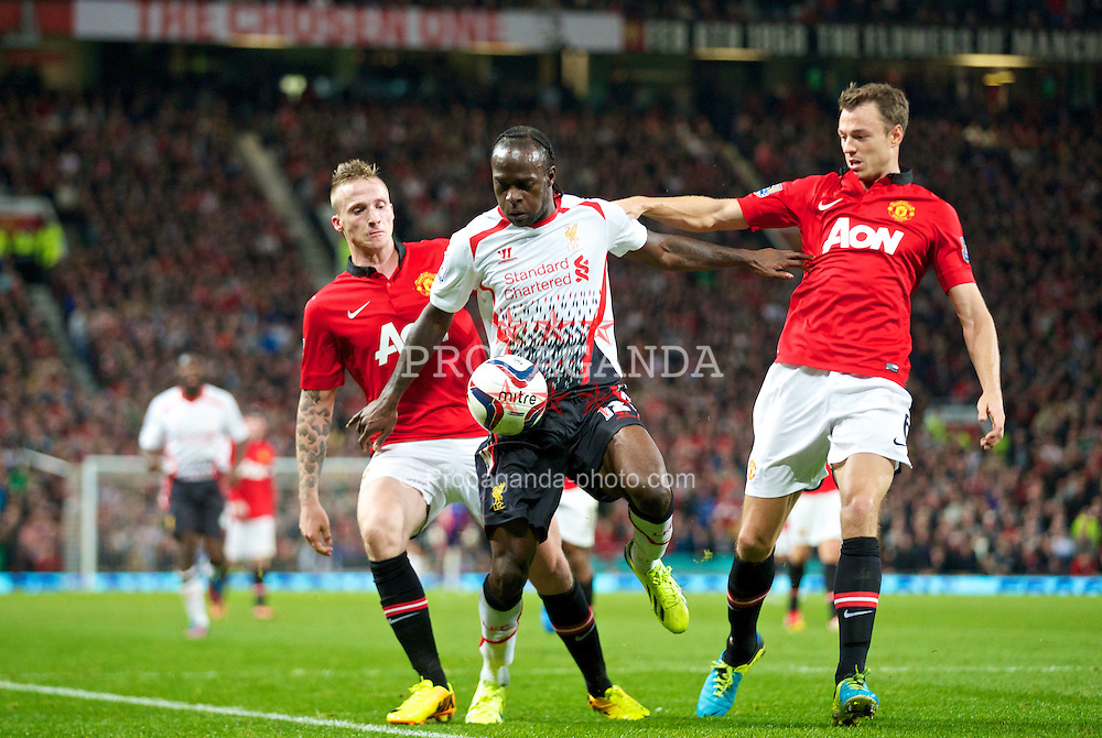 MANCHESTER, ENGLAND - Wednesday, September 25, 2013: Liverpool's Victor Moses in action against Manchester United during the Football League Cup 3rd Round match at Old Trafford. (Pic by David Rawcliffe/Propaganda)