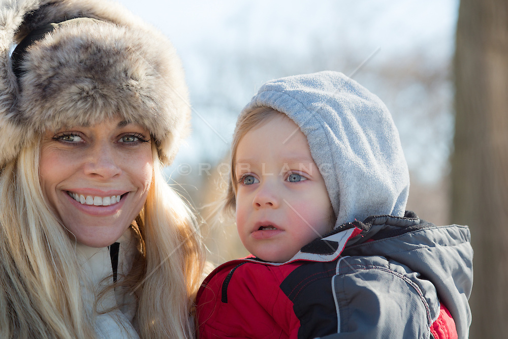 mother and her 2 year old son bundled up together outdoors in Central Park, New York City