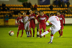 CARMARTHEN, WALES - Wednesday, October 20, 2010: Wales' captain Adam Matthews scores from the penalty spot with virtually the last kick of the match to make it 3-3 against Turkey during the UEFA Under-19 Championship Qualifying Group 1 match at Richmond Park. (Photo by Gareth Davies/Propaganda)