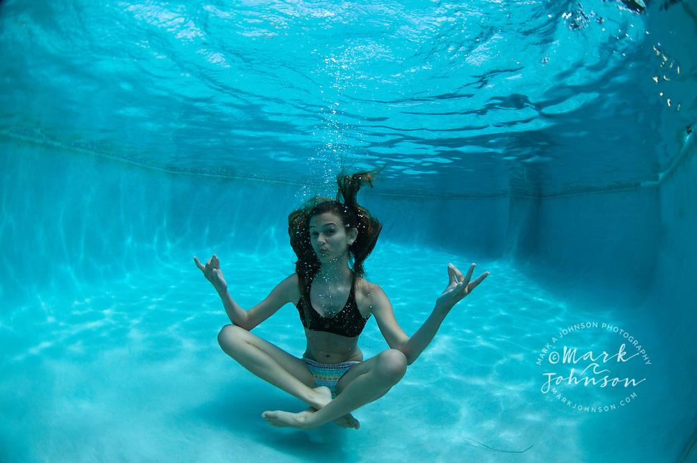 13 year old girl underwater in swimming pool, Kauai, Hawaii