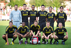 ZUG, SWITZERLAND - Wednesday, July 21, 2010: Liverpool players line-up for a team-group photograph wearing their new black and yellow adidas kit for the first time before the Reds' first preseason match of the 2010/2011 season against Grasshopper Club Zurich at the Herti Stadium. Back row L-R: goalkeeper Diego Cavalieri, Daniel Sanchez Ayala, David Ngog, Martin Kelly, Nathan Eccleston, Alberto Aquilani. Front row L-R: Philipp Degen, David Amoo, captain Lucas Leiva, Stephen Darby, Jay Spearing. (Pic by David Rawcliffe/Propaganda)