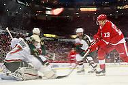 January 25, 2013; Detroit, MI, USA; Detroit Red Wings center Pavel Datsyuk (13) tries to score on Minnesota Wild goalie Josh Harding (37) in the third period at Joe Louis Arena. Mandatory Credit: Rick Osentoski-USA TODAY Sports
