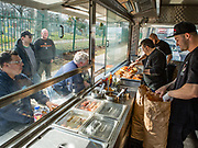 Patrons line up for Italian sausages at D'Angelo's food trailer on Woodhaven Blvd. in Queens. The trailer kitchen was built out by 800BuyCart. At the grill is D'Angelo's owner Gary D'Angelo. Gary's nephew Angel Bonilla is on the right.