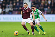 Manuel Milinkovic (#11) of Heart of Midlothian on the ball under pressure from Lewis Stevenson (#16) of Hibernian during the William Hill Scottish Cup 4th round match between Heart of Midlothian and Hibernian at Tynecastle Stadium, Gorgie, Scotland on 21 January 2018. Photo by Craig Doyle.
