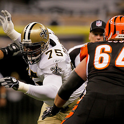 2009 August 14: New Orleans Saints defensive tackle Rod Coleman (75) rushes past Cincinnati Bengals center Kyle Cook (64) during a preseason opener between the Cincinnati Bengals and the New Orleans Saints at the Louisiana Superdome in New Orleans, Louisiana.