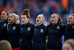 SOUTHAMPTON, ENGLAND - Friday, April 6, 2018: Wales players sing the national anthem before the FIFA Women's World Cup 2019 Qualifying Round Group 1 match between England and Wales at St. Mary's Stadium. Charlie Estcourt, Angharad James, Jessica Fishlock, Natasha Harding. (Pic by David Rawcliffe/Propaganda)