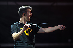 © Licensed to London News Pictures . 01/07/2017 . Manchester , UK . Conductor Tim Crooks , wearing a t-shirt with a worker bee , the emblem of Manchester . Hacienda Classical play at the Castlefield Bowl as part of Sounds of the City , during the Manchester International Festival . A collaboration between DJs Mike Pickering and Graeme Park and the Manchester Camerata orchestra , Hacienda Classical reworks music by bands including the Happy Mondays and New Order and features Manchester musicians including Rowetta and Peter Hook . Photo credit : Joel Goodman/LNP