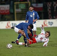 26/03/2005 WARSAW POLAND<br /> 26/03/2005 POLAND v AZERBAIJAN World Cup 2006 Qualifying Group 6 <br /> ASLAN KERIMOW /8 AZERBAIJAN L/ & EBI SMOLAREK /16 POLAND/<br /> FOT: PIOTR HAWALEJ /Digitalsport