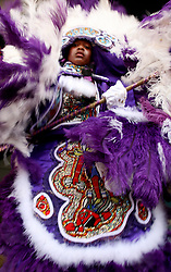 30 April 2006. New Orleans, Louisiana. Jazzfest . <br /> The first New Orleans Jazz and Heritage festival following the disaster of Hurricane Katrina. <br /> A child dressed in traditional Mardi Gras Indian costume dances on the Jazz and Heritage stage.<br /> <br /> Photo ©Charlie Varley/varleypix.com<br /> All rights reserved.