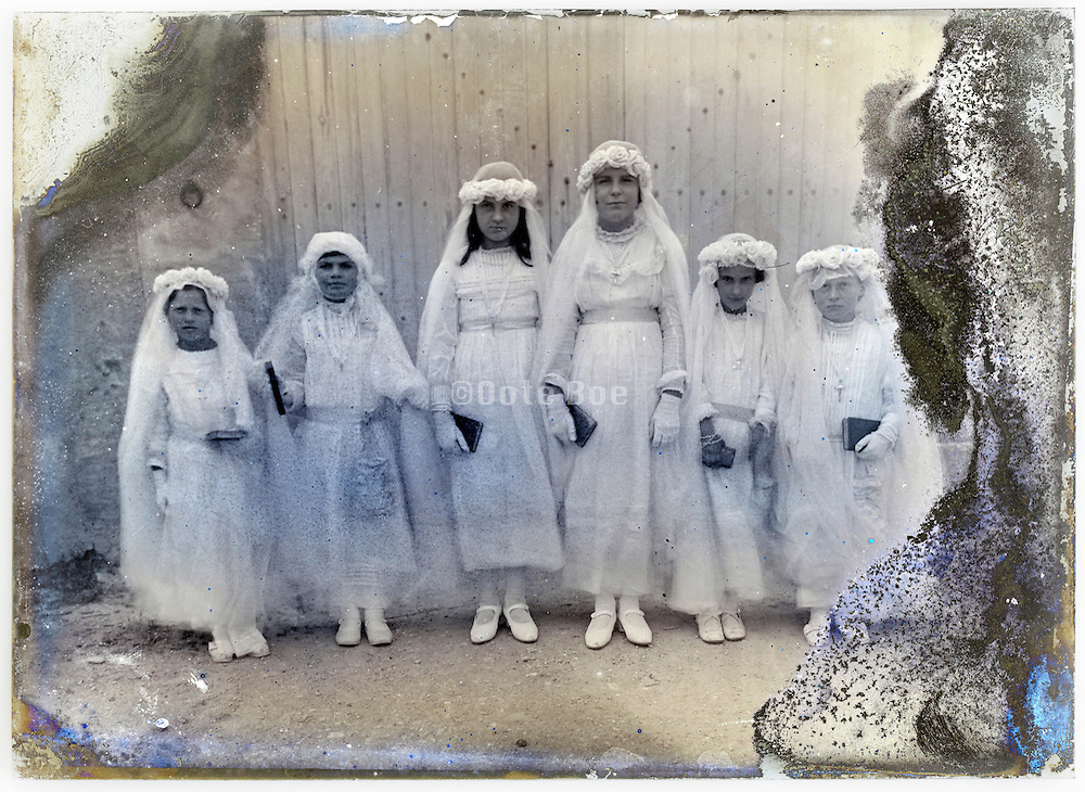 eroding glass plate with young girls posing in holy communion clothing