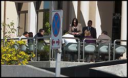 Rebecca Blake and Conor McRedmond (not in frame) at Dubai Courts, Dubai, UAE, February, 2013. Photo by Logan Fish / i-Images..Rebecca Blake distinguishing clothing: Tan jacket, black sunglasses, straight black hair.Conor McRedmond distinguishing clothing: Grey suit, white shirt, black sunglasses