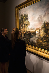 "Christie's, St James, London. Two members of staff admire the brush stroke of one of Britain's most loved painters as Christie's in London announce the sale of a work of genius by John Constable, the full scale six-foot ""sketch"" for ""View on the Stour near Dedham"" painted between 1821 and 1822, which is expected to fetch between £18-22 million at auction."