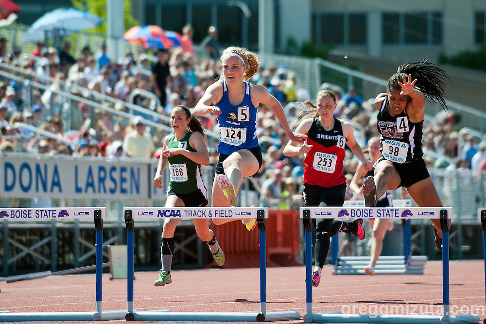 Centennial sophomore Tatyana Jones and Coeur d'Alene junior Kaitlyn Gunnerson on the final hurdle in the Idaho 5A State Track &amp; Field Championships 300 meter hurdles final at Dona Larsen Park, Boise, Idaho on May 17, 2014.<br />