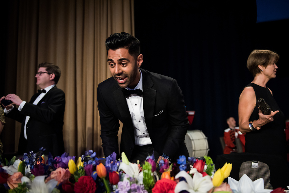 Hasan Minhaj, Senior Correspondent o the Daily Show on Comedy Central, stands on stage ahead of his hosting the White House Correspondents' Dinner in Washington, D.C. on April 29, 2017. CREDIT: Mark Kauzlarich for CNN