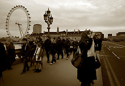 UK ENGLAND LONDON 20DEC11 - A Muslim female tourist takes a picture on Westminster Bridge, central London.....jre/Photo by Jiri Rezac....© Jiri Rezac 2011
