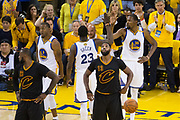Golden State Warriors forward Kevin Durant (35) and Golden State Warriors forward Draymond Green (23) high five in between plays against the Cleveland Cavaliers during Game 5 of the NBA Finals at Oracle Arena in Oakland, Calif., on June 12, 2017. (Stan Olszewski/Special to S.F. Examiner)