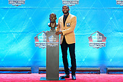 Aug 3, 2019; Canton, OH, USA; Champ Bailey poses with bust during the Pro Football Hall of Fame Enshrinement at Tom Benson Hall of Fame Stadium. (Robin Alam/Image of Sport)