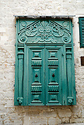 Ornate, carved wooden shutters. Sibenik, Croatia