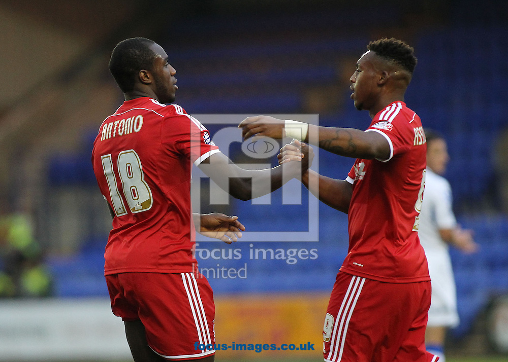 Michail Antonio of Nottingham Forest celebrates with Britt Assombalonga after scoring the first goal against Tranmere Rovers during the Capital One Cup match at Prenton Park, Birkenhead.<br /> Picture by Michael Sedgwick/Focus Images Ltd +44 7900 363072<br /> 12/08/2014
