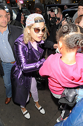 Rita Ora arrives at Cafe de Paris in central London wearing a shiny purple mac, with a pink t-shirt and Jeans, reflective glasses and a baseball cap with offensive text printed on it. London. UK. 23/05/2013<br />BYLINE MUST READ : GOTCHAIMAGES.COM<br /><br />Copyright by © Gotcha Images Ltd. All rights reserved.<br />Usage of this image is conditional upon the acceptance <br />of Gotcha Images Ltd, terms and conditions available at<br />www.gotchaimages.com