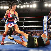 "Noemi ""NoNo"" Bosques (red) and Yolaine LinDeLauf fight during a Telemundo boxing match at the A La Carte Pavilion on Friday, August 1, 2014 in Tampa, Florida. Bosques won the fight and the Women's Florida State Flyweight Title belt after dropping LinDeLauf three times. (AP Photo/Alex Menendez)"