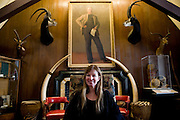 Lorie Karnath, president of The Explorers Club, in the Trophy Room of the club, New York City...Founded in New York City in 1904, The Explorers Club promotes the scientific exploration of land, sea, air, and space by supporting research and education in the physical, natural and biological sciences. The Club's members have been responsible for an illustrious series of famous firsts: First to the North Pole, first to the South Pole, first to the summit of Mount Everest, first to the deepest point in the ocean, first to the surface of the moon--all accomplished by our members.