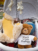 """12 JUNE 2020 - MINNEAPOLIS, MINNESOTA: Teddy bear and children's toys left at the impromptu memorial for George Floyd at the corner of 38th Street and Chicago Ave. in Minneapolis. The intersection is informally known as """"George Floyd Square"""" and is considered a """"police free zone."""" There are memorials to honor Black people killed by police and people providing free food at the intersection. Floyd, an unarmed Black man, was killed by Minneapolis police on May 25 when an officer kneeled on his neck for 8 minutes and 46 seconds. Floyd's death sparked weeks of ongoing protests and uprisings against police violence around the world.          PHOTO BY JACK KURTZ"""
