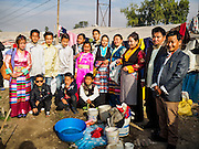 04 MARCH 2017 - KATHMANDU, NEPAL: A portrait of an extended Nepali Sherpa family in an IDP camp in the center of Kathmandu. They were dressed to go to a Tibetan New Years ceremony at a Buddhist temple about 10 miles from the camp. The families live in the mountains far north of Kathmandu and came to the city after the earthquake. The camp opened days after the April 2015 earthquake devastated Nepal, killing almost 9,000 people. At its peak, about 1,800 families lived in the camp. The camp is still open nearly two years after the earthquake, about 400 families currently live in the camp. Camp residents say the Kathmandu municipal government is trying to close the camp and is encouraging residents to find new housing. They said the government is cutting off services to the camp and last week stopped the free distribution of water, although water can be purchased for delivery. Most of the people in the camp came to Kathmandu from rural villages in the mountains in the weeks after the earthquake. Many of the residents of the camp, technically homeless, have found work in Kathmandu's bustling construction industry, rebuilding homes destroyed in the earthquake.       PHOTO BY JACK KURTZ