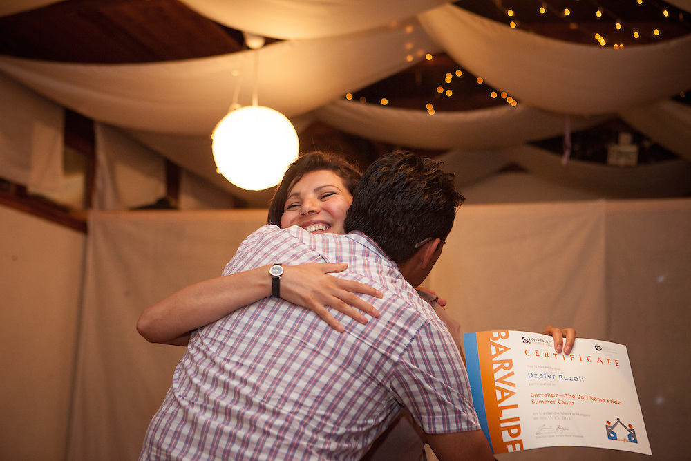 Barvalipe: The 2nd Roma Pride Summer Camp for young Roma from Central and Eastern Europe at Szentendre Island near Budapest, Hungary. Participant Dzafer Buzoli from Kosovo getting his certificate from Violeta during the final evening celebration.