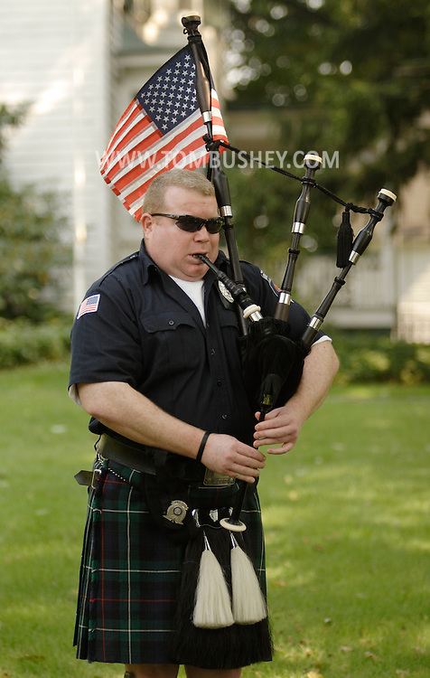 Middletown, N.Y. - A bagpiper from the Middlesex County (N.J.) Police and Fire Pipes and Drums practice before marching in the  Middletown Fire Department's 147th Anniversary Fire Parade on Sept. 9, 2006. ©Tom Bushey