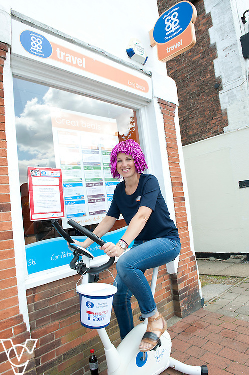 Pictured is Long Sutton travel centre colleague Suzy Williams<br /> <br /> Lincolnshire Co-operative colleagues have been raising money for the Teenage Cancer Trust during their 'Get Wiggy With It' day!<br /> <br /> Date: July 31, 2015
