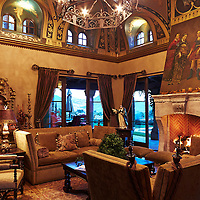 Interior luxury home with religious icon art work .