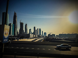 Pic of skyscrapers, in Dubai. Images from the MSC Musica cruise to the Persian Gulf, visiting Abu Dhabi, Khor al Fakkan, Khasab, Muscat, and Dubai, traveling from 13/12/2015 to 20/12/2015.