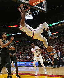 February 9, 2018 - Miami, FL, USA - The Miami Heat's Hassan Whiteside dunks against the Milwaukee Bucks' Giannis Antetokounmpo during the second quarter at the AmericanAirlines Arena in Miami on Friday, Feb. 9, 2018. The Heat won, 91-85. (Credit Image: © David Santiago/TNS via ZUMA Wire)