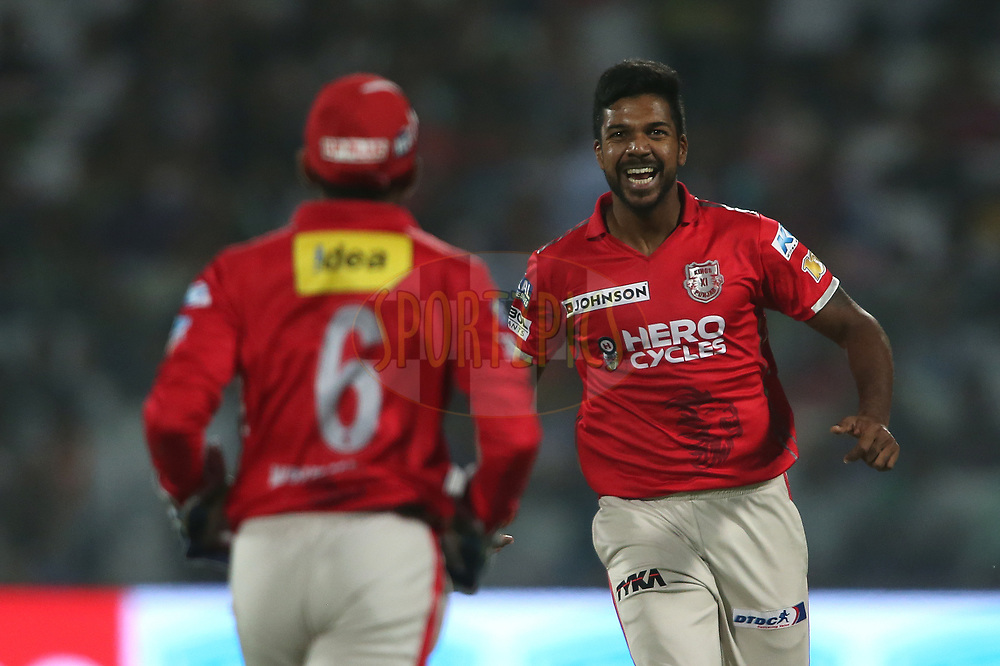 Varun Aaron of Kings XI Punjab and Wriddhiman Saha of Kings XI Punjab celebrate getting Karun Nair of the Delhi Daredevils wicket during match 15 of the Vivo 2017 Indian Premier League between the Delhi Daredevils  and the Kings XI Punjab held at the Feroz Shah Kotla Stadium in Delhi, India on the 15th April 2017<br /> <br /> Photo by Shaun Roy - Sportzpics - IPL