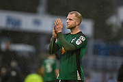 Scunthorpe United Midfielder, Neal Bishop (12) applauding the fans during the EFL Sky Bet League 1 match between Bristol Rovers and Scunthorpe United at the Memorial Stadium, Bristol, England on 25 February 2017. Photo by Adam Rivers.