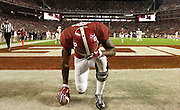 Gary Cosby Jr./Decatur Daily   Amari Cooper kneels in prayer in the back of the end zone after catching a long touchdown pass during the second half of the 2014 Iron Bowl game in Bryant-Denny Stadium.
