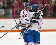 Fairport players Mason Eichmann and Tyler Sullivan celebrate Sullivan's second period goal during a game against Pittsford at RIT on Saturday, January 24, 2015.