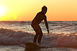 Silhouette of freshwater surfer in Lake Michigan at sunset