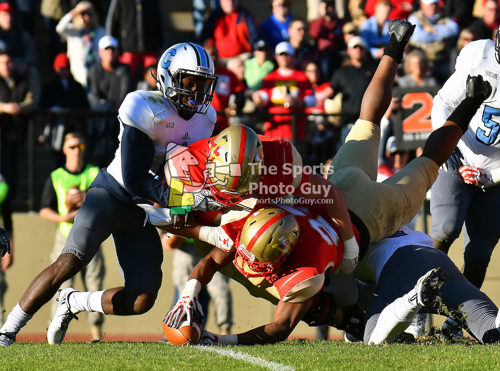 NCAA Football: #5 Citadel fends off VMI in Military Classic of the South, 30-20 - VMI running back Tyain Smith extends the ball across the goal line for a touchdown in the 3rd quarter of VMI's 20-30 loss the the 5th-ranked Citadel Bulldogs on Saturday in Lexington.