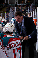 KELOWNA, CANADA - JANUARY 9:  Alex Swetlikoff #17 of the Kelowna Rockets speaks to head coach Adam Foote on the bench against the Everett Silvertips on January 9, 2019 at Prospera Place in Kelowna, British Columbia, Canada.  (Photo by Marissa Baecker/Shoot the Breeze)